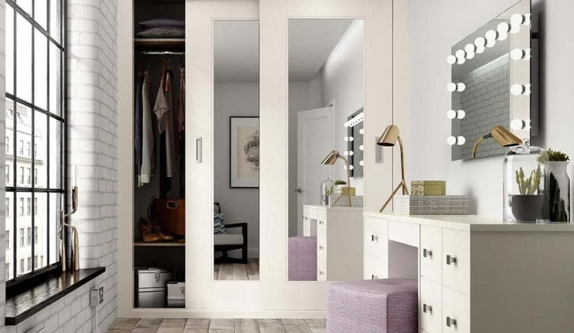 harspden sliding wardrobes in white with an open door