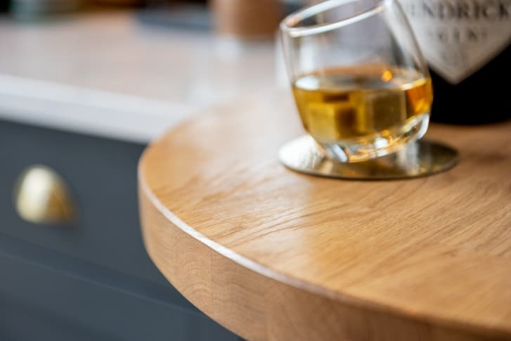 croft kitchen close up of drinks wooden worktop with glass of whiskey