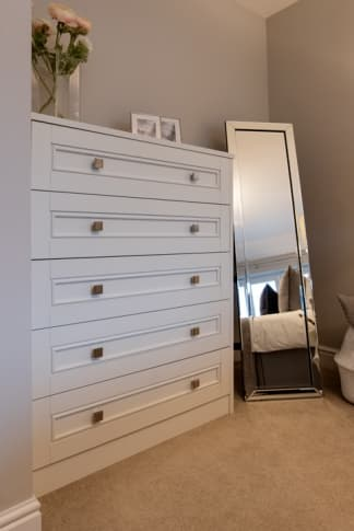 White chest of drawers with free standing mirror