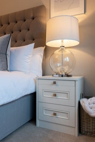 White bedside table with lamp